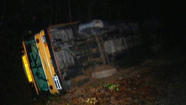 The overturned bus along Pond Road. (Dec. 10, 2012/FOX Carolina)