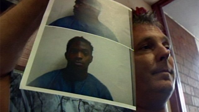 Steven Grich's father holds of a photo of Lester Mosley Jr. after the other 3 suspects' bond hearing on Tuesday. (Dec. 11, 2012/FOX Carolina)