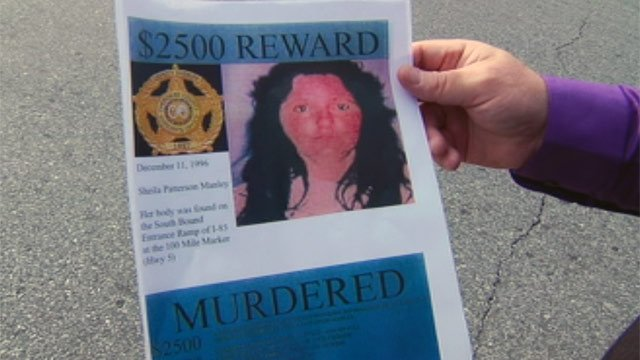Cherokee County Sheriff Steve Mueller passes out flyers for the Sheila Manley cold case. (Dec. 11, 2012/FOX Carolina)
