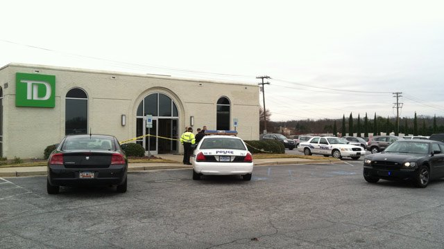 Greenville police respond to a robbery at the TD Bank on Wade Hampton Blvd. (Dec. 12, 2012/FOX Carolina)