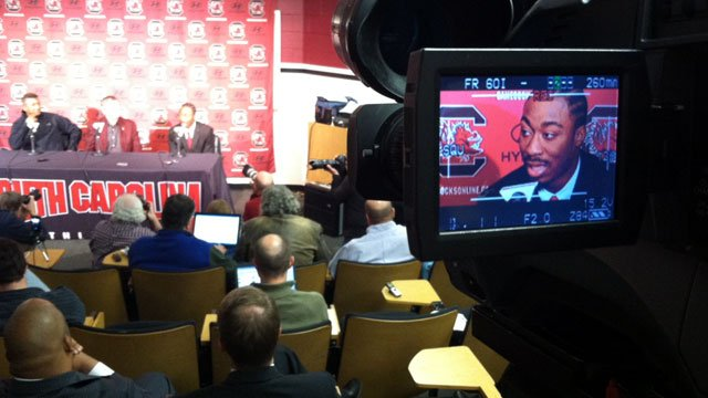 Marcus Lattimore appears in the viewfinder of a television camera while he discusses his decision to turn pro. (Dec. 12, 2012/FOX Carolina)