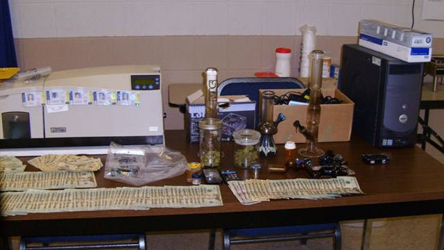 Some of the cash, fake ID machine and drugs deputies seized. (Dec. 12, 2012/Pickens Co. Sheriff's Office)