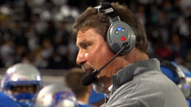 Chris Miller speaks into a headset during a Byrnes High School football game. (File/FOX Carolina)