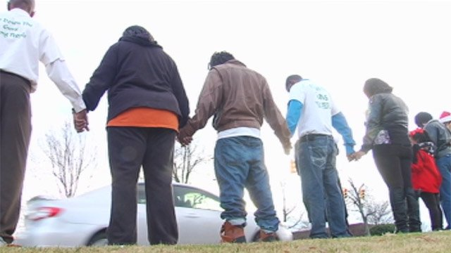 Supporters gathered along Woodruff Road for a vigil on Saturday. (Dec. 15, 2012/FOX Carolina)