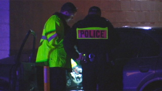 Police investigate the alleged robber's car that crashed into the Little Caesar's restaurant along W. Butler Road. (Dec. 16, 2012/FOX Carolina)