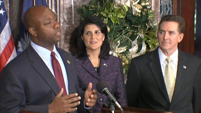 Gov. Nikki Haley appoints U.S. Rep. Tim Scott (left) as her replacement for Sen. Jim DeMint in Columbia. (Dec. 17, 2012/FOX Carolina)