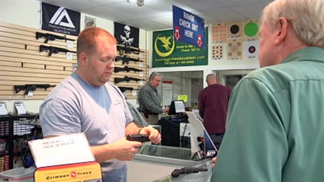 Customers look at guns for sale at Allen Arms in Greenville. (Dec. 18, 2012/FOX Carolina)