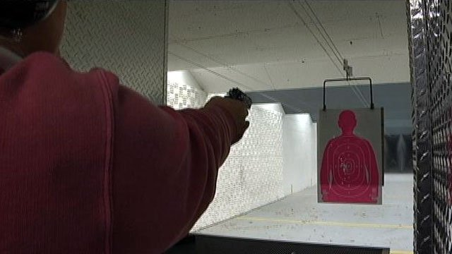 A gun owner takes aim at a target at a Greenville gun range. (Dec. 26, 2012/FOX Carolina)