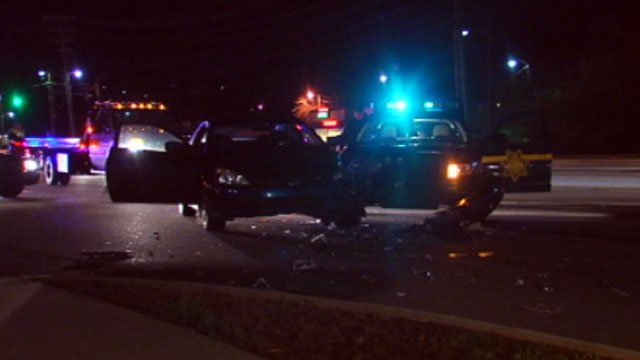 Debris is strewn about the scene of a crash involving the cruiser of a Greenville County deputy. (Dec. 26, 2012/FOX Carolina)