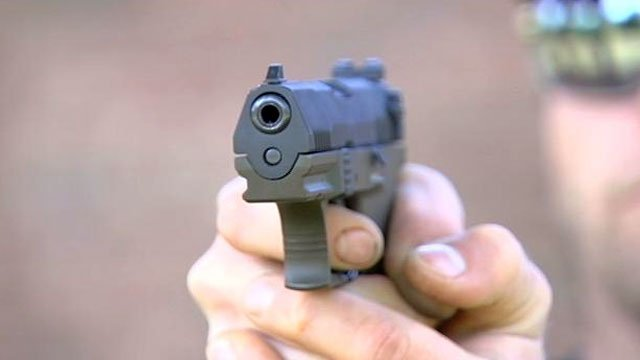 A man takes aim with his handgun at an outdoor firing range. (File/FOX Carolina)