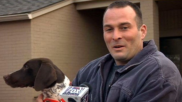 Jason Tharp holds his dog, Lexi, after they were reunited. (Dec. 28, 2012/FOX Carolina)