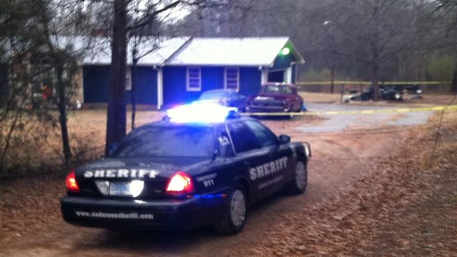 Deputies respond to the River Road home in Piedmont where they say a woman was set on fire by her son. (Jan. 1, 2013/FOX Carolina)