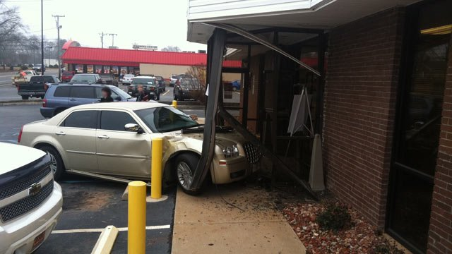 A gold sedan crashed into this BB&T Bank in Piedmont on Thursday. (Jan. 3, 2013/FOX Carolina)