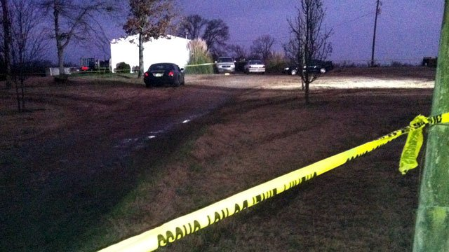 Crime scene tape blocks the driveway that leads to an Elbert County home where a shooting happened. (Jan. 3, 2013/FOX Carolina)