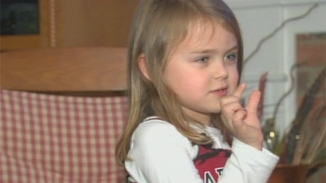 Logan Foster shows how far she thought the referee was off when he made the first down call during Tuesday's game. (Jan. 3, 2013/FOX Carolina)