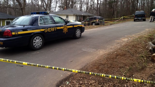 Crime scene tape blocks Springbrook Drive after a body was found in the area. (Jan. 8, 2013/FOX Carolina)