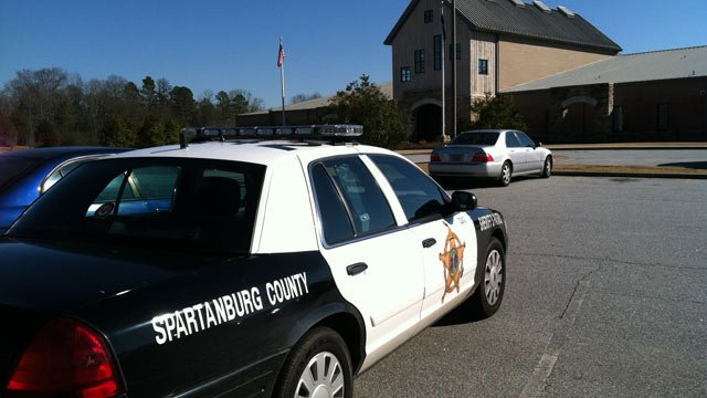 An off-duty Spartanburg County deputy offers additional safety at Anderson Mill Elementary School. (File/FOX Carolina)