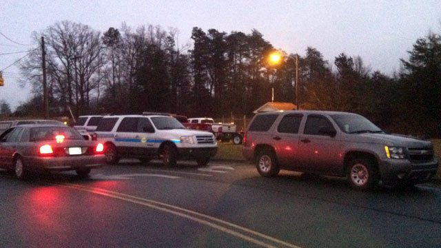 Authorities comb the scene of where a body believed to be that of a missing woman was found. (Jan. 11, 2013/FOX Carolina)