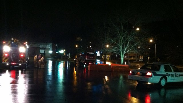 Emergency crews along Charlotte street where the van's driver stopped and discovered the pedestrian. (Jan. 14, 2013/FOX Carolina)