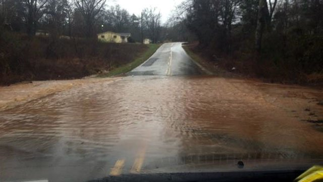 Water flows over West Georgia Road near Piedmont after a day of heavy rains. (Jan. 17, 2013/FOX Carolina iWitness)