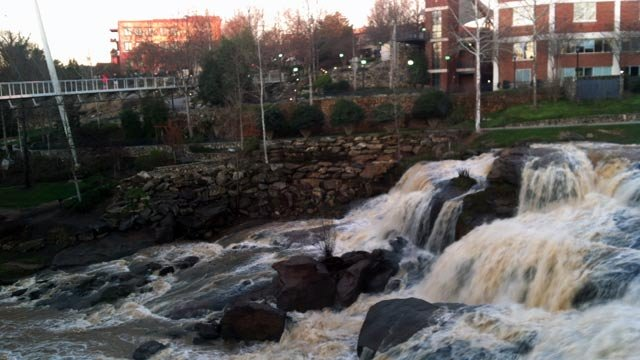 Following several days of rain, the Reedy River was flowing strong over the downtown falls Friday morning. (Jan. 18, 2013/FOX Carolina)