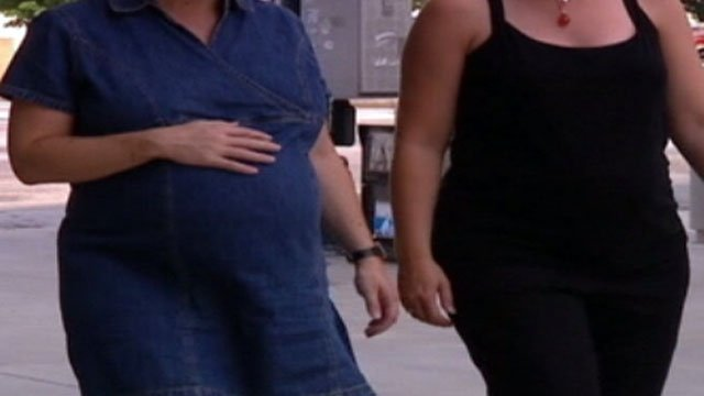 Pregnant women walk down a Greenville street. (File/FOX Carolina)