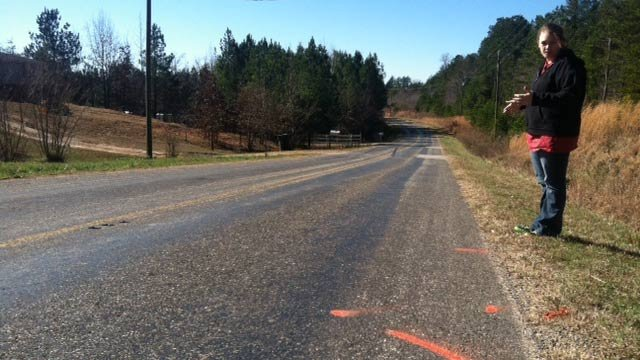 The girl's sister stands next to where she was hit along Hopewell Road Monday night. (Jan. 22, 2013/FOX Carolina)