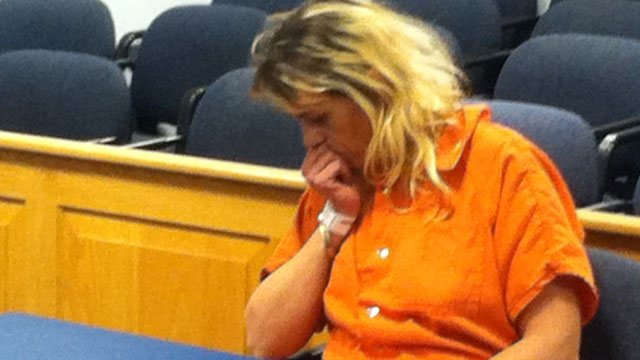 Nikki Waters rests her head on her arm during a bond hearing. (Jan. 23, 2012/FOX Carolina)