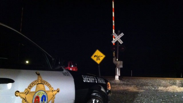 A deputy's cruiser is parked at a railroad crossing after a pedestrian was hit by a train near Greer. (Jan. 23, 2013/FOX Carolina)