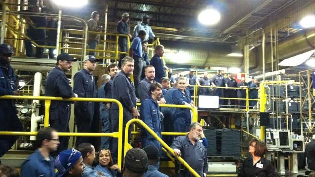 Workers at the Starr Michelin plant gather around for the economic announcement. (Jan. 24, 2013/FOX Carolina)