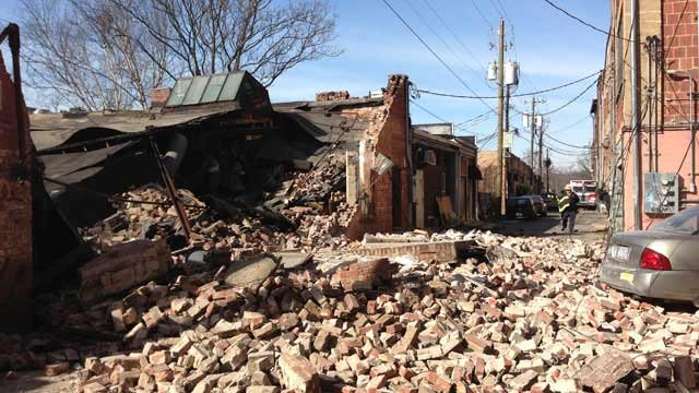 Bricks scattered along Carolina Lane after the building collapsed. (Jan. 24, 2013/Kelley Klope for Asheville Fire Dept.)