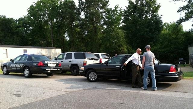Investigators comb the scene of a shooting that killed a toddler in Anderson County. (July 3, 2012/FOX Carolina)