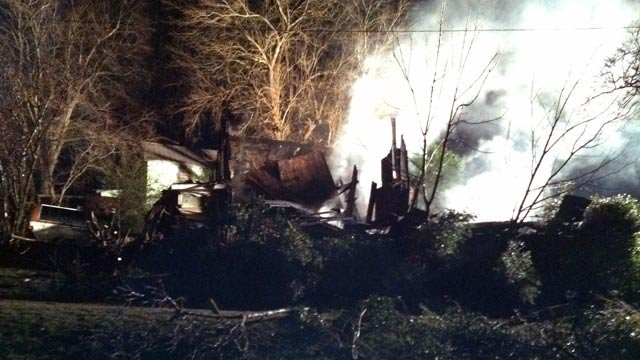 Smoke rises from the charred remains of a Converse home. (Jan. 25, 2013/FOX Carolina)