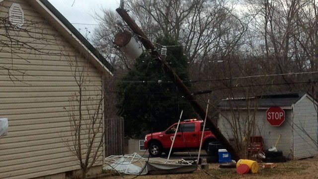 A power pole leans on an Inman home after stiff winds pushed it over. (Jan. 30, 2013/FOX Carolina)