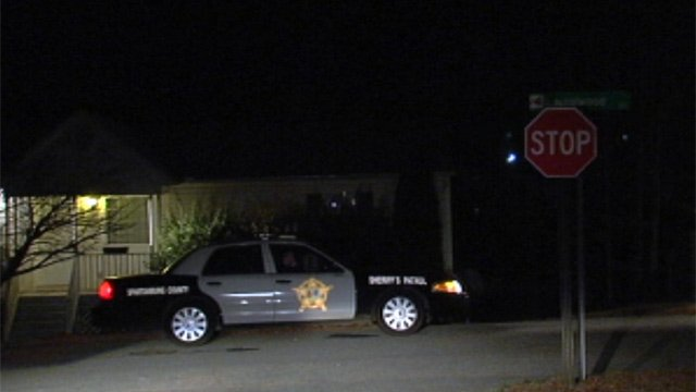 A Spartanburg County deputy outside of the woman's Boiling Springs home on Tuesday. (Jan. 29, 2013/FOX Carolina)