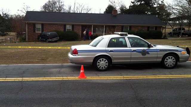 A trooper's cruiser blocks off part of River Road in Anderson County after a car hit a house. (Jan. 30, 2013/FOX Carolina)