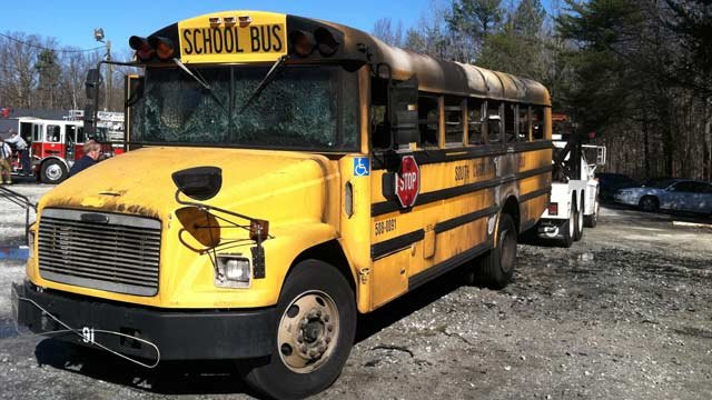 The burned out school bus is towed away. (Feb. 1, 2013/FOX Carolina)