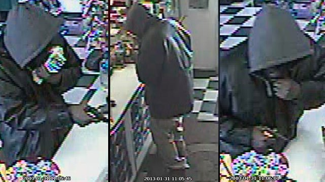 Deputies say these pictures were taken during a robbery in Greenville County. (Jan. 31, 2013/FOX Carolina)