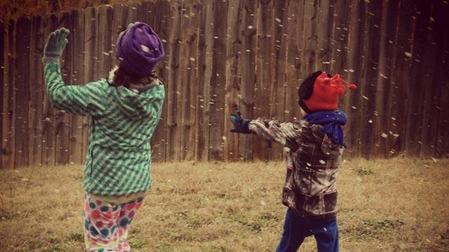 Children play as snow flurries fall in Easley. (Feb. 2, 2013/FOX Carolina iWitness)
