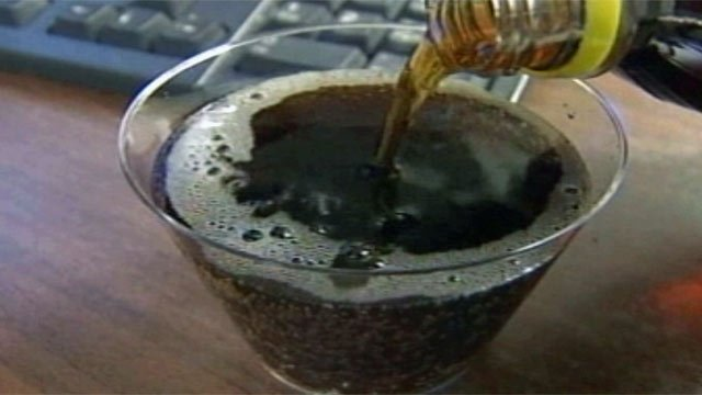 Someone fills a cup with soda. (File/FOX Carolina)