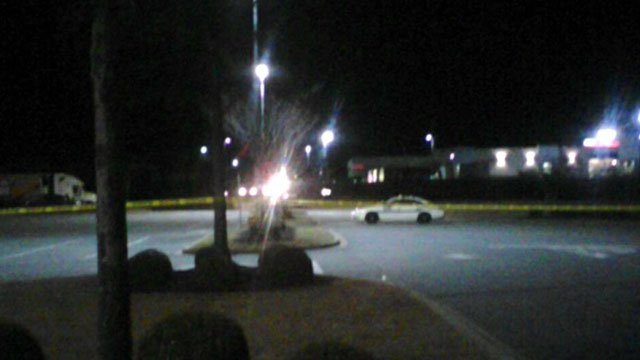 Crime scene tape cordons off a part of the parking lot at a shopping center in Taylors. (Feb. 4, 2013/FOX Carolina)