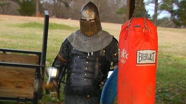 Trey Sutter trains in his suit of armor for the Battle of the Nations Team USA competition.  (Feb. 4, 2013/FOX Carolina)
