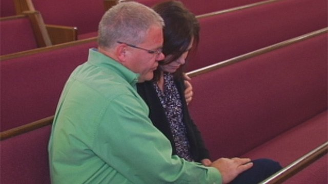 Doug and Sue Dean pray at their local church. (File/FOX Carolina)
