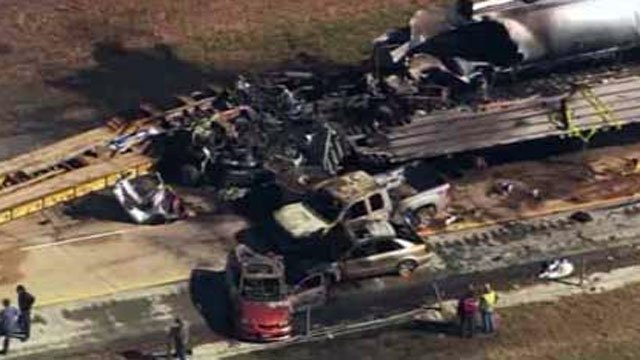 Authorities look over the charred remains of vehicles after a fiery crash on a Georgia interstate. (Feb. 6, 2013/CNN/WSB)