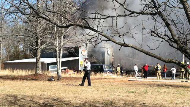The structure on Studebaker Road in Chesnee smolders. (Feb. 6, 2013/FOX Carolina)