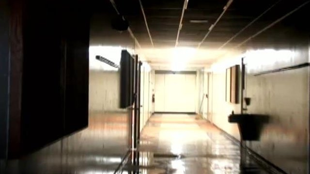 Fluorescent lights glow in the halls of the vacant Chesnee Elementary School in this image taken from Kevin Turner's documentary. (YouTube)