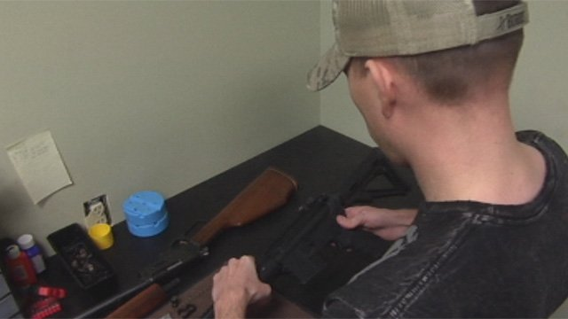 John Simmons works on a custom-made gun at Sharpshooters in Greenville. (Feb. 8, 2013/FOX Carolina)