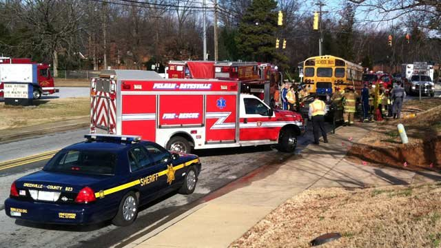 Firefighters, deputies and troopers work to rescue driver that crashed into school bus on S. Batesville Road. (Feb. 8, 2013/FOX Carolina)