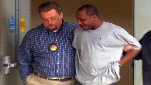 Marcus Osbey (right) is walked out of the Spartanburg County Sheriff's Office after his arrest. (Feb. 8, 2013/FOX Carolina)
