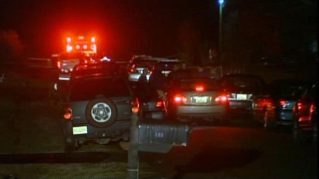 Several cars are parked along a Williamston street after a deputy-involved shooting. (Feb. 11, 2013/FOX Carolina)